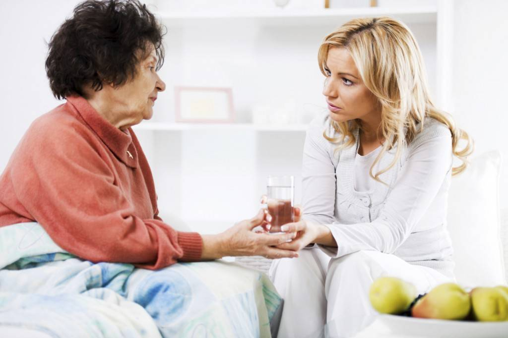 caring-caregiver-with-ill-woman-1024x6821